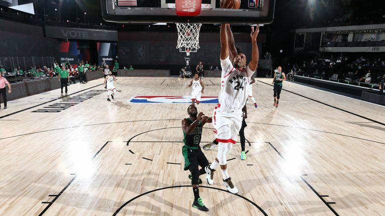 Marcus Smart #36 of the Boston Celtics blocks the shot by Norman Powell #24 of the Toronto Raptors during Game Seven of the Eastern Conference Semifinals of the NBA Playoffs on September 11, 2020 at The AdventHealth Arena at ESPN Wide World Of Sports Complex in Orlando, Florida.