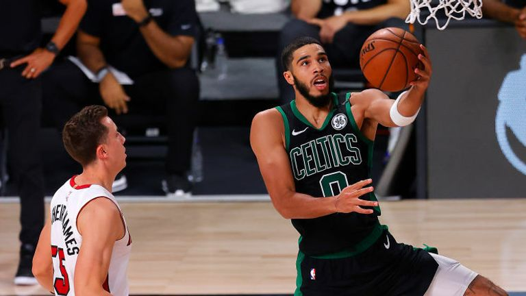 Jayson Tatum #0 of the Boston Celtics goes for a lay-up against Duncan Robinson #55 of the Miami Heat during the fourth quarter in Game Five of the Eastern Conference Finals during the 2020 NBA Playoffs at AdventHealth Arena at the ESPN Wide World Of Sports Complex on September 25, 2020 in Lake Buena Vista, Florida.