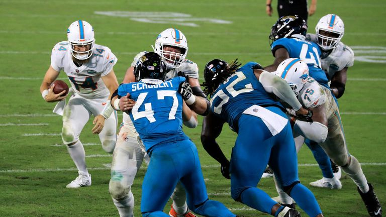 Ryan Fitzpatrick #14 of the Miami Dolphins runs for a for a touchdown during the game against the Jacksonville Jaguars at TIAA Bank Field on September 24, 2020 in Jacksonville, Florida.