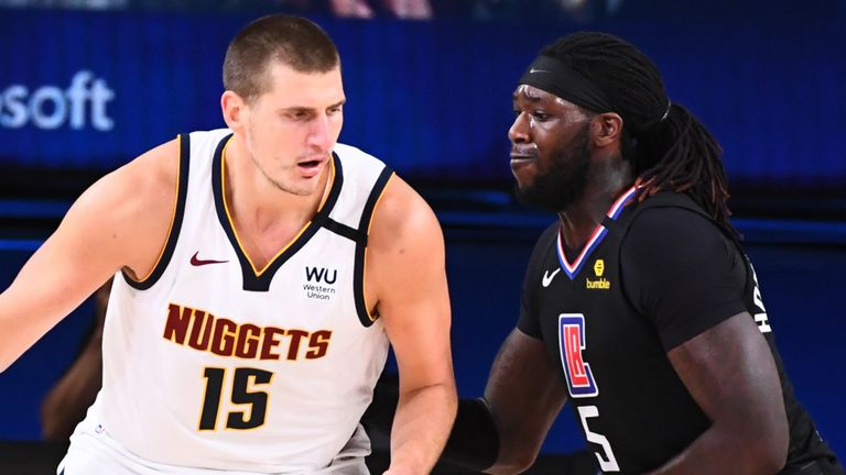 Nikola Jokic backs down Clippers defender Montrezl Harrell in the Nuggets' Game 2 win