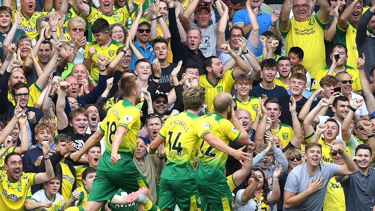 Norwich City fans celebrate after striker Teemu Pukki scores during a Premier League game at Carrow Road in 2019