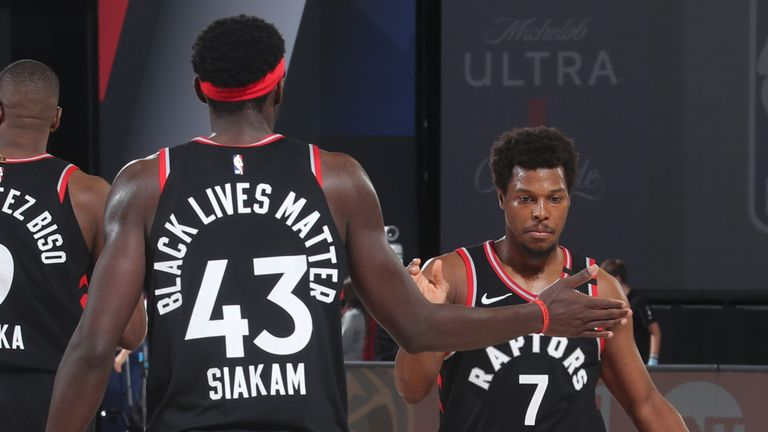 Pascal Siakam and Kyle Lowry of the Toronto Raptors hi-five during the game against the Boston Celtics during Game Four of the Eastern Conference Semi-finals