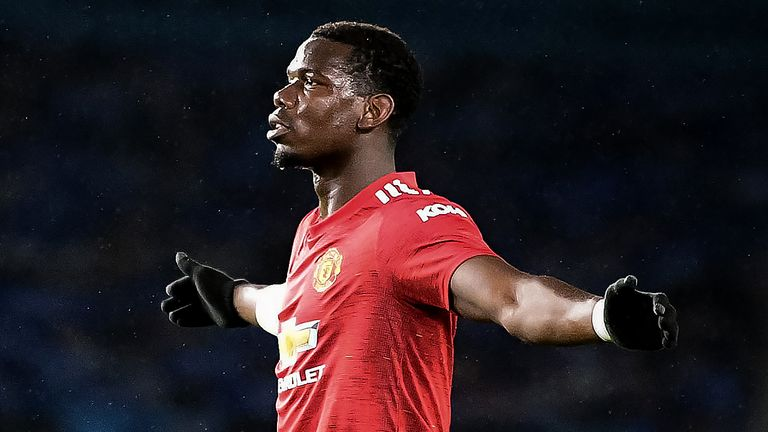 Paul Pogba celebrates after scoring Manchester United's third goal against Brighton