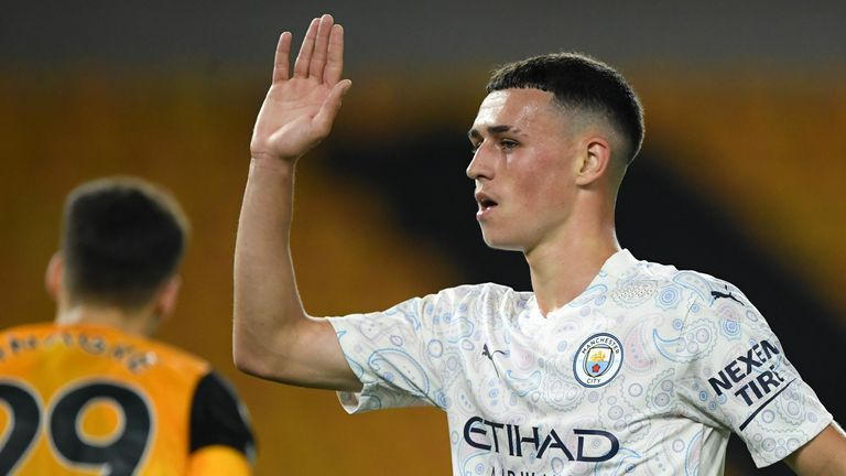 Phil Foden celebrates his goal at Molineux