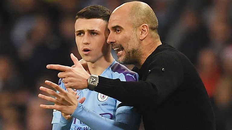 Phil Foden with Pep Guardiola