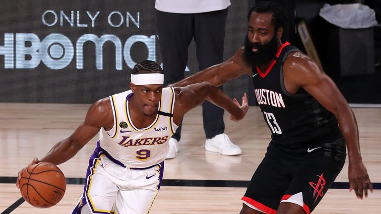 Rajon Rondo of the Los Angeles Lakers drives the ball against James Harden of the Houston Rockets during the first quarter in Game Three of the Western Conference