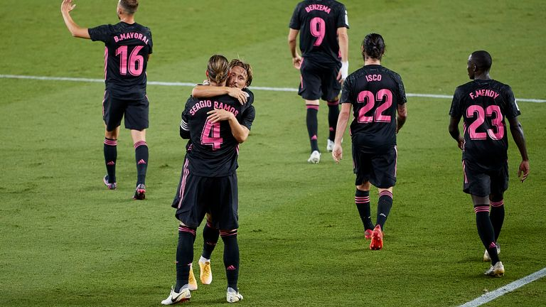 Luka Modric embraces Sergio Ramos after the defender's winning penalty