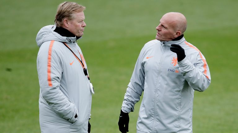 Ronald Koeman and Rene Wormhoudt discuss matters during a Netherlands training session