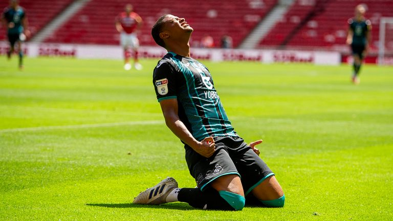 Brewster celebrates scoring for Swansea against Middlesbrough in the Championship in June