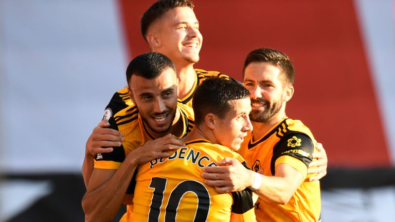 Romain Saiss is mobbed after doubling Wolves' lead