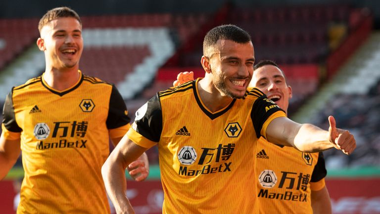 Romain Saiss celebrates scoring Wolves' second goal