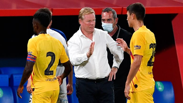 Ronald Koeman congratulates his Barca players at the full-time whistle