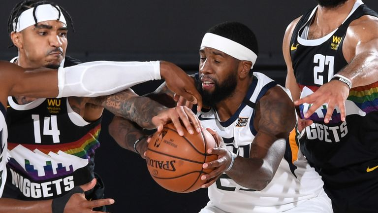 Utah Jazz forward Royce O'Neale wrestles for possession in Game 7 against the Nuggets