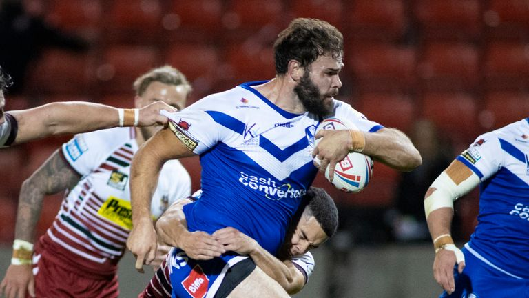 Try-scorer Alex Walmsley takes on the Wigan defence