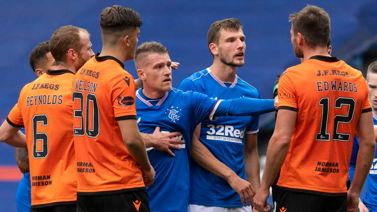 GLASGOW, SCOTLAND - SEPTEMBER 12: The Rangers' players react angrily to a challenge made on Alfredo Morelos by Dundee United's Ryan Edwards during a Scottish Premiership match between Rangers and Dundee United at Ibrox Stadium, on September 12, 2020, in Glasgow, Scotland. (Photo by Alan Harvey / SNS Group)
