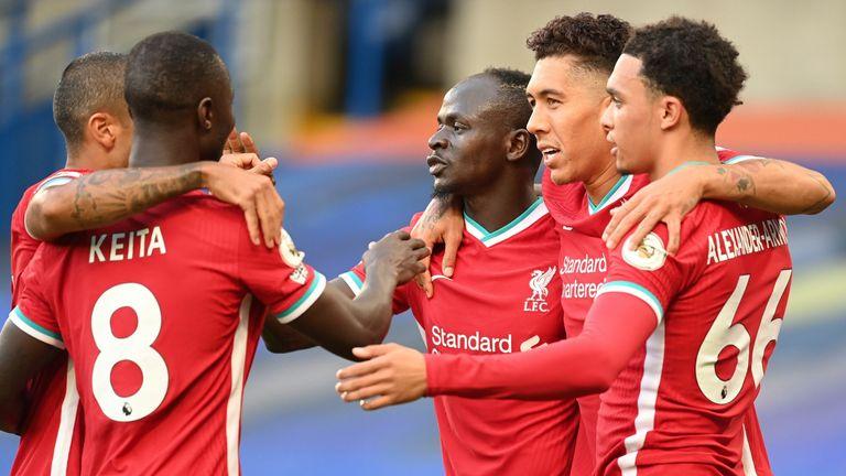 Sadio Mane celebrates with team-mates after scoring the opening goal