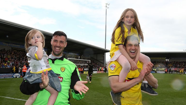 Scott Shearer and John Mousinho during the Sky Bet League Two match between Burton Albion and Northampton Town at Pirelli Stadium on April 25, 2015 in Burton-upon-Trent, England.
