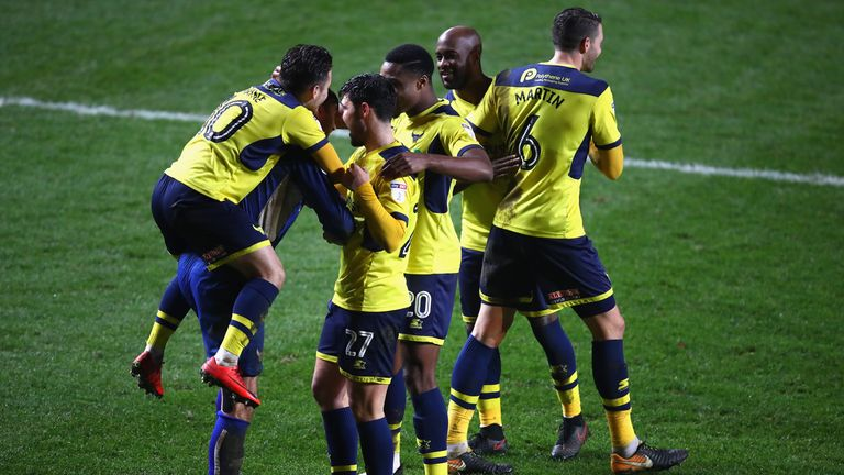 Scott Shearer is mobbed by team-mates following the EFL Checkatrade Trophy Third Round match between Charlton Athletic and Oxford United at The Valley on January 9, 2018 in London, England.