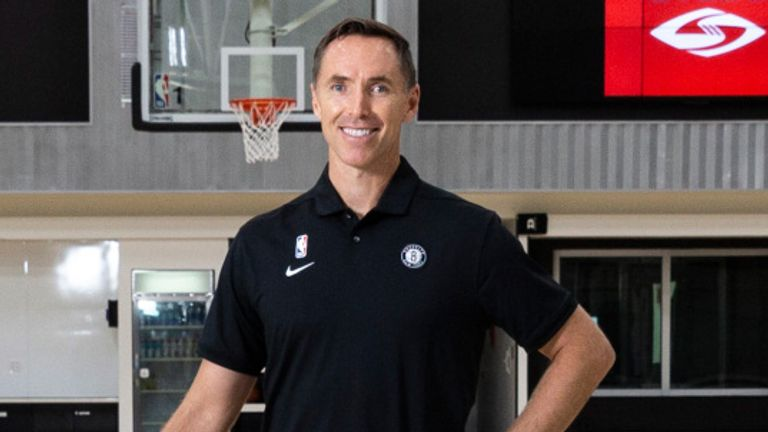 Steve Nash poses for pictures at the Brooklyn Nets training facility