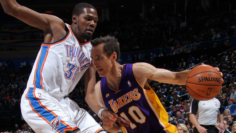 Steve Nash of the Los Angeles Lakers drives to the basket against Kevin Durant of the Oklahoma City Thunder