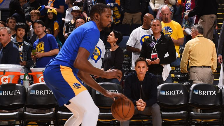 Steve Nash looks on as Kevin Durant of the Golden State Warriors warms up prior to the game against the Indiana Pacers