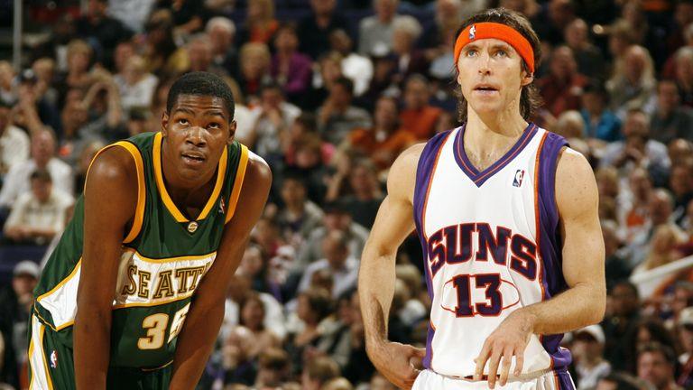 Kevin Durant of the Seattle SuperSonics and Steve Nash of the Phoenix Suns catch their breath during the game