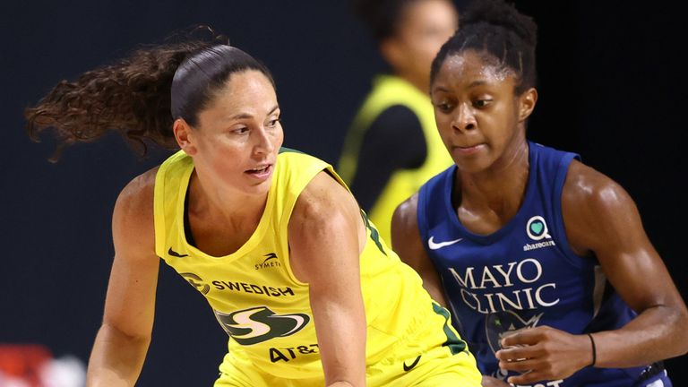 Sue Bird of the Seattle Storm posts up Crystal Dangerfield of the Minnesota Lynx