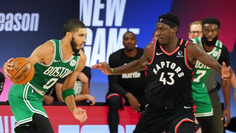 Jayson Tatum of the Boston Celtics handles the ball against Pascal Siakam of the Toronto Raptors during Round Two, Game Six of the Eastern Conference Semifinals