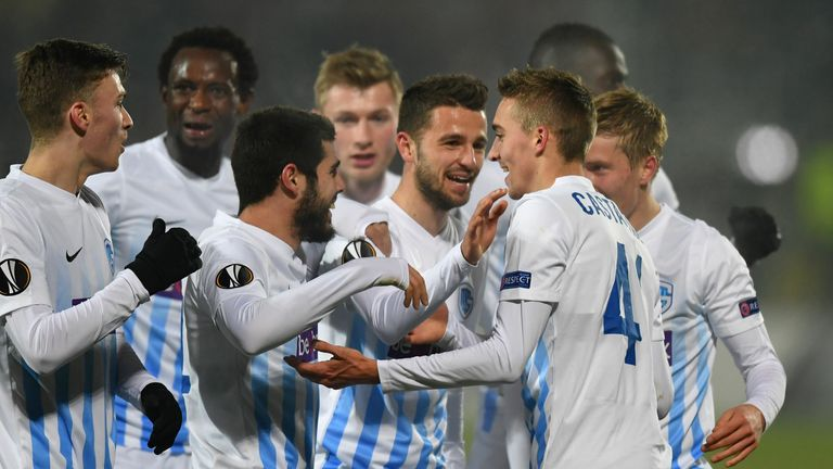 Timothy Castagne (R) of KRC Genk celebrates scoring the 1-0 goal with his teammates during the UEFA Europa League round of 32 first-leg football match between FC Astra and RC Genk in Giurgiu, Romania on February 16, 2017.