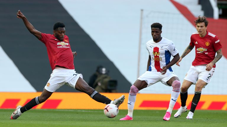 Timothy Fosu-Mensah (L) in action with Wilfried Zaha