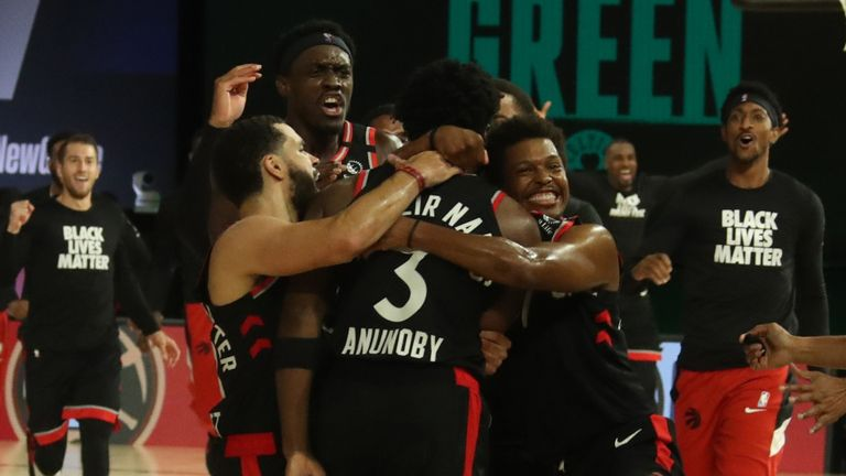 OG Anunoby is mobbed by his Raptors team-mates after draining a three-pointer at the buzzer to beat the Boston Celtics in Game 3 of the Eastern Conference semi-final