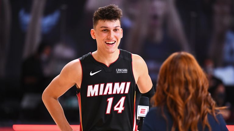 Tyler Herro of the Miami Heat smiles and talks the media on the court after Game Four of the Eastern Conference Finals against the Boston Celtics