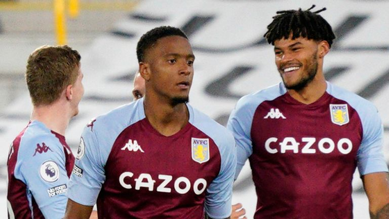 Tyrone Mings celebrates after Villa extend their lead at Craven Cottage