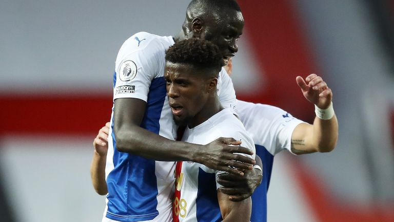 Wilfried Zaha celebrates scoring his second goal