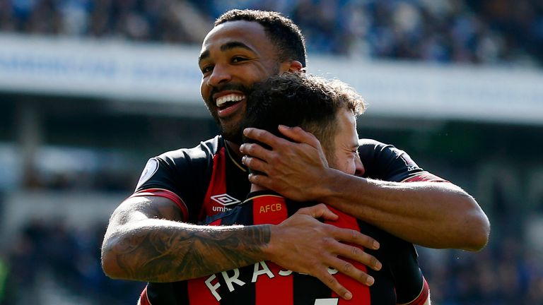 Ryan Fraser of AFC Bournemouth celebrates with teammate Callum Wilson after scoring his team's second goal during the Premier League match between Brighton & Hove Albion and AFC Bournemouth at American Express Community Stadium on April 13, 2019 in Brighton, United Kingdom.