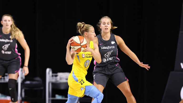 Courtney Vandersloot provided a WNBA record 18 assists as the Chicago Sky beat the Indiana Fever.