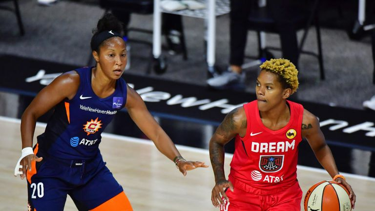 Courtney Williams #10 of the Atlanta Dream controls the ball against Briann January #20 of the Connecticut Sun during the first half at Field Entertainment Center on September 11, 2020 in Palmetto, Florida.