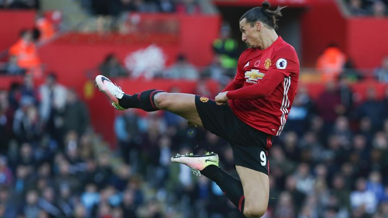 Manchester United's Swedish striker Zlatan Ibrahimovic jumps and kicks the air as he celebrates scoring his team's second goal during the English Premier League football match between Swansea City and Manchester United at The Liberty Stadium in Swansea, south Wales on November 6, 2016