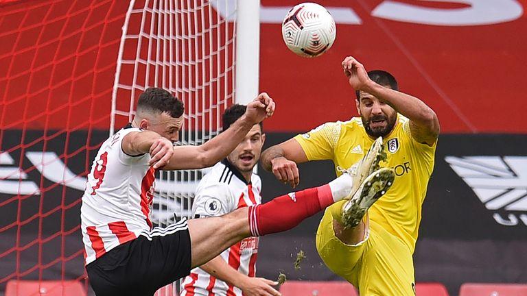 Aleksandar Mitrovic (R) fouls Sheffield United's English defender Jack Robinson (L) for a penalty