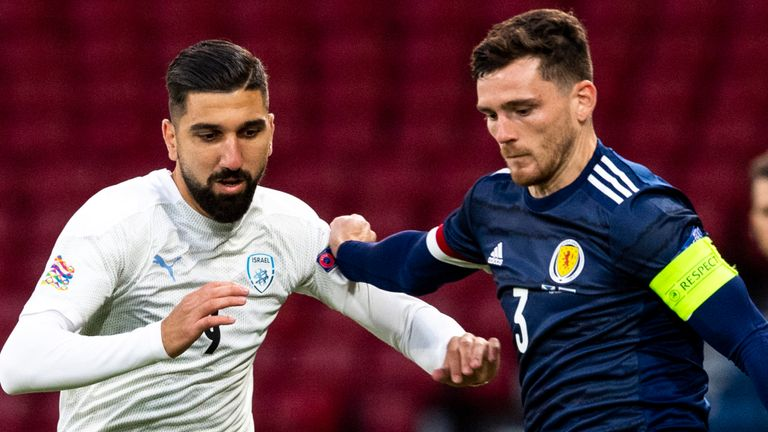 Scotland's Andrew Robertson and Munas Dabbur in action