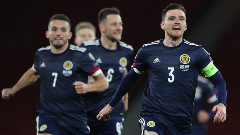 Andy Robertson leads Scotland's celebrations after beating Israel on penalties