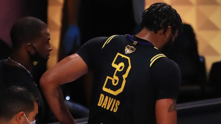 Anthony Davis is helped off the court after aggravating a heel injury in Game 5 of the NBA Finals