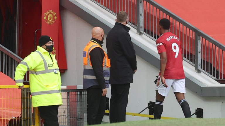 Anthony Martial makes his way down the tunnel following his red card