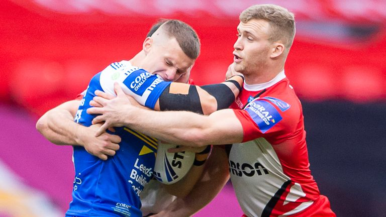 Leeds try-scorer Ash Handley is tackled by Salford's Joey Lussick