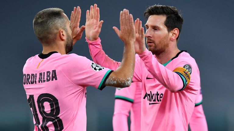 Lionel Messi celebrates after he scored in Barcelona's win at Juventus