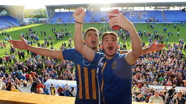 Ben Godfrey and Christos Shelis of Shrewsbury Town celebrate at full time after the Sky Bet League One Play Off Semi Final:Second Leg between Shrewsbury Town and Charlton Athletic at New Meadow on May 13, 2018 in Shrewsbury, England