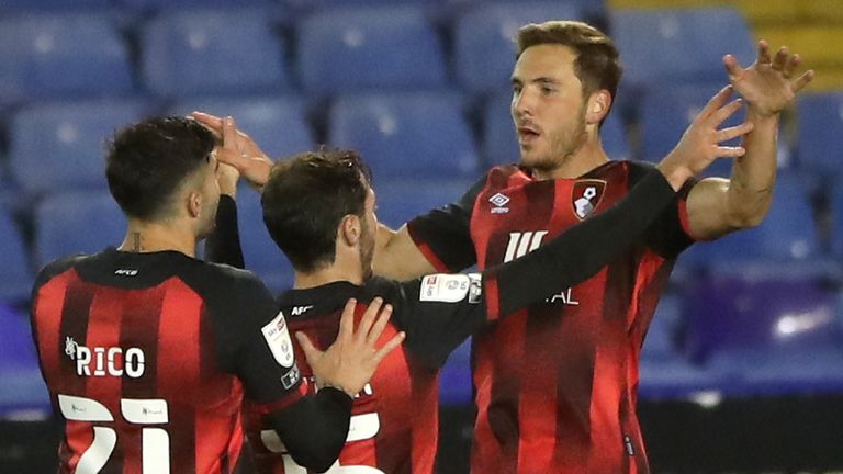 AFC Bournemouth's Dan Gosling (right) celebrates scoring his side's second goal against Coventry