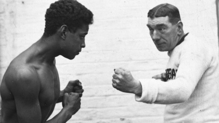 Johnson pictured with his sparring partner in December 1926