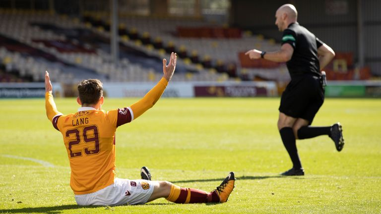 Motherwell's Callum Lang appeals to referee Bobby Madden for a penalty