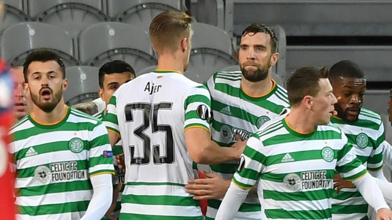 Celtic's players celebrate after scoring a goal against Lille